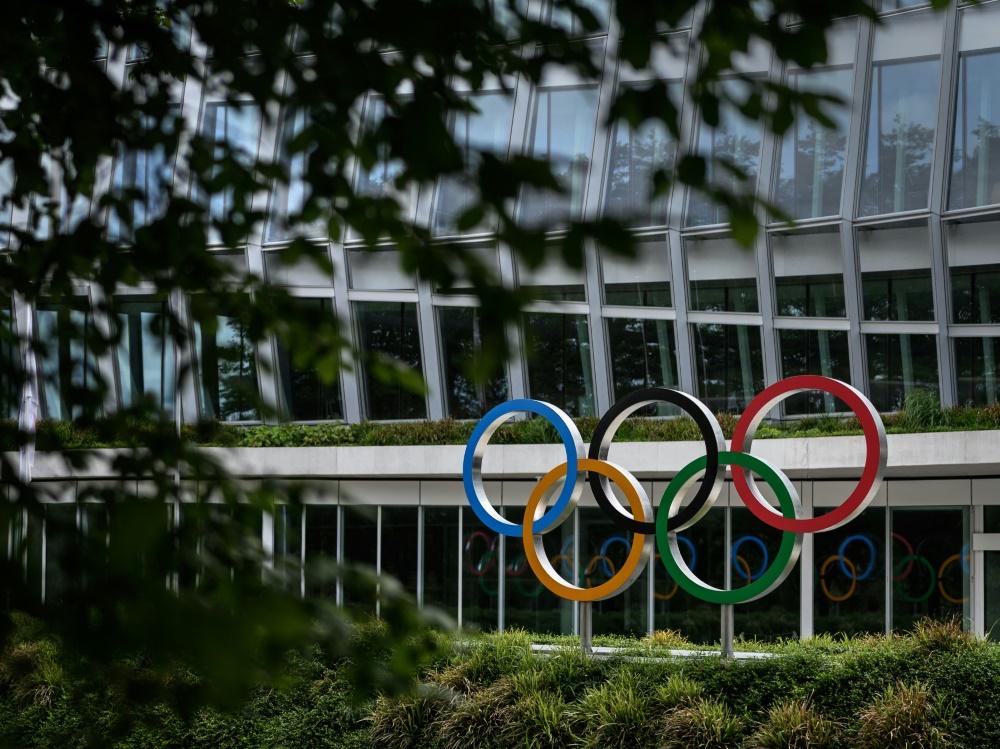 Human Rights Watch fordert das IOC zum Handeln auf (© AFP/SID/FABRICE COFFRINI)